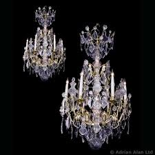 a fine pair of louis xv style six light rock crystal cage chandeliers