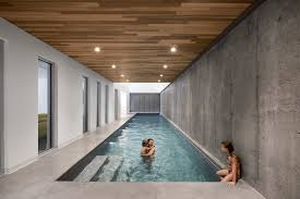 indoor swimming pool house. Beautiful Pool Long Rectangular Pool With Hardwood Ceiling And Recessed Lights Inside Indoor Swimming Pool House