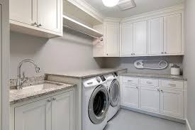 white shaker laundry room cabinets with gray granite countertops