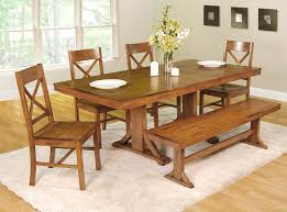 this dining room set with bench is going for the antique look with an antique brown