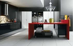 crystal chandelier over red kitchen island of modern kitchen design
