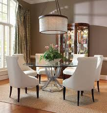 beautiful dining space with modern chandelier amazing glass table top