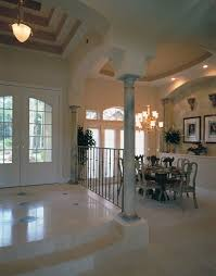 formal dining rooms with columns. unusually tall ceilings and decorative marble columns open up the formal dining room to equally rooms with o