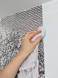 How To Install Wallpaper In A Bathroom HGTV - Trim around bathroom mirror