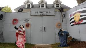 trump clinton haunt u s halloween display newsweek middle east a halloween display featuring a border wall and figures of donald trump hillary clinton and