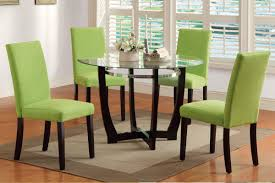 green chairs of contemporary dining room sets with bucket white flower and some handkerchif roll on the round glass table furniture