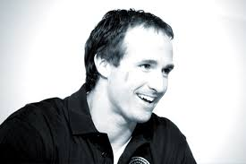 Image of Drew Brees speaking at an event. Drew Brees - twitter-box-drew-brees