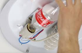 how to remove a stuck light bulb bottles using coca cola