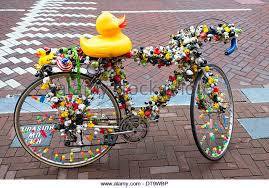Bicycle decorated with plastic ducks and toys, Amsterdam, Netherlands -  Stock Image