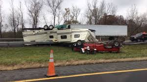 Truck towing camper flips, crashes on Thruway near Pittsford | WHAM