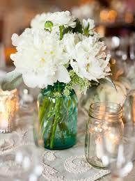 Blue Mason Jars Wedding Decor blue mason jar wedding centerpiece with white flowers iPunya 15
