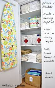 and i love the cute basketetal dividers for the shelves in this lovely linen closet makeover via simplicity in the south