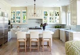 kitchens with white cabinets. Windows Form The Back Walls Of Glass-doored Cabinets, Allowing Light To Pour In And Illuminate Simple White Kitchen. Calacatta Marble Counters A Kitchens With Cabinets