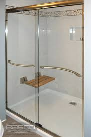 infinity frameless sliding shower door featuring bronze finish and 1 4 clear glass with