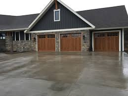 enjoy the beauty of a wood look garage door