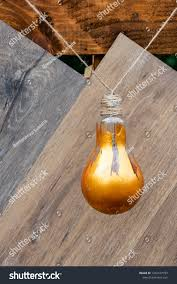 Amber Light Bulb Paint Light Bulb Painted Golden Paint Used Stock Photo Edit Now