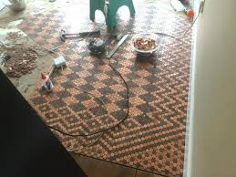 woman glues 150 in pennies to her ugly floor to create a stunning design