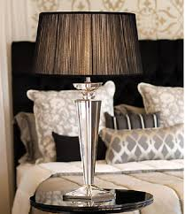 adorable design of the bedroom areas with white bed and black lamp shades with glass legs