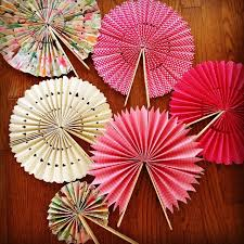 diy paper fans cute idea for outdoor weddings and place on each guest seat