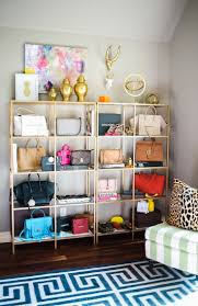home office shelving units. Glam Home Office Also Doubles As A Closet Featuring Wall Lined With Gold Shelving Units Glass Shelves, Ikea Vittsjo Unit, S