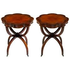 elegant 1940s mahogany spider leg end tables with tooled leather top for