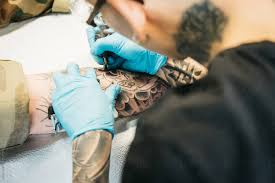 Stock Photo Male Tattoo Artist Tattoos Females Leg