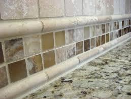 travertine tile backsplash with glass accent