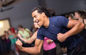 man smiling during group exercise cl
