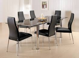 fabulous dark glass top dining room tables rectangular and black chairs on laminate wood flooring near simple wall inside spacious dining space with flower