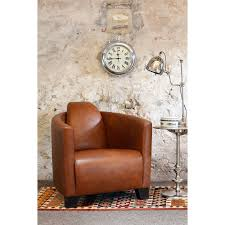 leather tub chair in a light brown leather in brando style with curving arms and large loading zoom