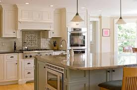 A Contemporary L Shaped Kitchen With High End Appliances And A Cream Subway  Tile