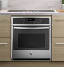 single wall oven with a cooktop wall