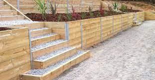 build retaining wall timber sleepers