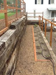 railroad tie retaining wall and tomato