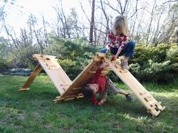 imagiplanks were created by scott moore a dad who came up with the idea after seeing his kids playing with s wood leftover from the playhouse he had