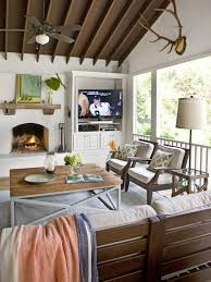 could do without the tv but i like the fireplace an indoor outdoor awesome pendant lighting sloped ceiling