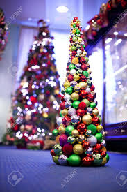 Christmas tree made from colourful balls. Another Christmas tree on the  background. Stock Photo