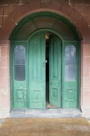 open house door. Arched Doorway With Green Painted Door Partially Open. Open House F
