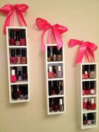 cute nail polish storage i found these wooden shelves at joann s they come in black or white i drilled holes in the top and pulled the satin ribbon