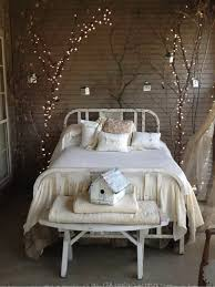 lighting twigs. fairy lights twigs around bed lighting