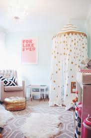 For Like Ever print, Land of Nod playhouse canopy, sheepskin rug, gold pouf