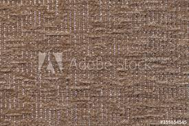 Dark brown fluffy background of soft fleecy cloth Texture of plush