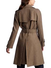 fabulous leather trench coat has a fitted shape and flared ruffled hem double ted with notch collar welt pockets and low slung buckle belt