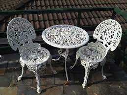 white iron garden table and chairs off