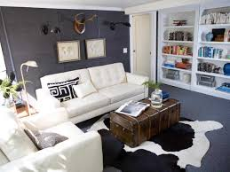 cowhide rug living room collection with ideas picture interior white tufted sofa and rugs plus grey area also bookshelves for cool