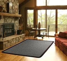 rectangular braided rugs a rectangular braided rug is right at home in this mountain home living