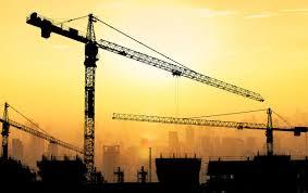 Big Cranes And Building Construction Against Dusky Sunset Sky Photo
