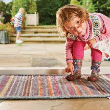 rug allergies small child standing on a muddy rug