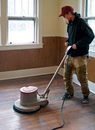 a floor polisher ed with a synthetic pad will make quick work of scuffing old coatings