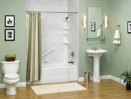 bathroom shower tile design color combinations: inviting blue sea color scheme and white bathtub also mount wall